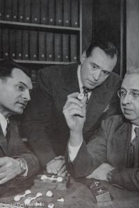 Fritz W. Jardon (Center) consults with colleagues.